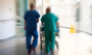Blurry A&E Picture of men in scrubs
