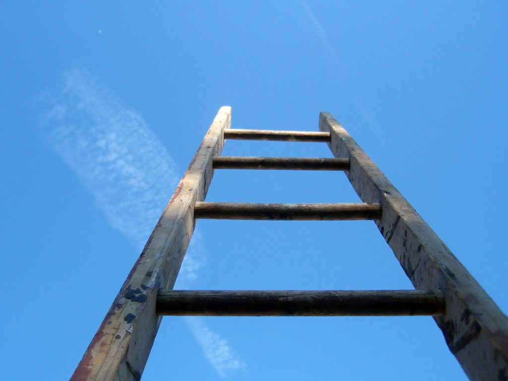 Ladder going up to blue sky